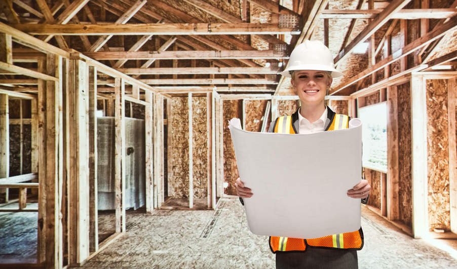 Smiling female architect holding